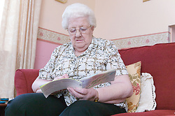 Older woman checking her pension book,