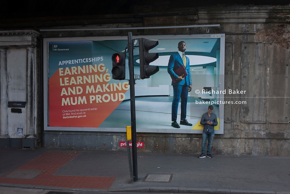 A government billboard campaign promotes working apprenticeships as an alternative to further education, seen at London Bridge in Southwark, south London.