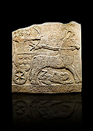 Hittite relief sculpted orthostat stone panel of Long Wall Limestone, Karkamıs, (Kargamıs), Carchemish (Karkemish), 900 -700 B.C. Anatolian Civilisations Museum, Ankara, Turkey<br /> <br /> Chariot. One of the two figures in the chariot holds the horse's headstall while the other throws arrows. There is a naked enemy with an arrow in his hip lying face down under the horse's feet. It is thought that this figure is depicted smaller than the other figures since it is an enemy soldier. The lower part of the orthostat is decorated with braiding motifs.<br /> <br /> On a black background. .<br />  <br /> If you prefer to buy from our ALAMY STOCK LIBRARY page at https://www.alamy.com/portfolio/paul-williams-funkystock/hittite-art-antiquities.html  - Type  Karkamıs in LOWER SEARCH WITHIN GALLERY box. Refine search by adding background colour, place, museum etc.<br /> <br /> Visit our HITTITE PHOTO COLLECTIONS for more photos to download or buy as wall art prints https://funkystock.photoshelter.com/gallery-collection/The-Hittites-Art-Artefacts-Antiquities-Historic-Sites-Pictures-Images-of/C0000NUBSMhSc3Oo