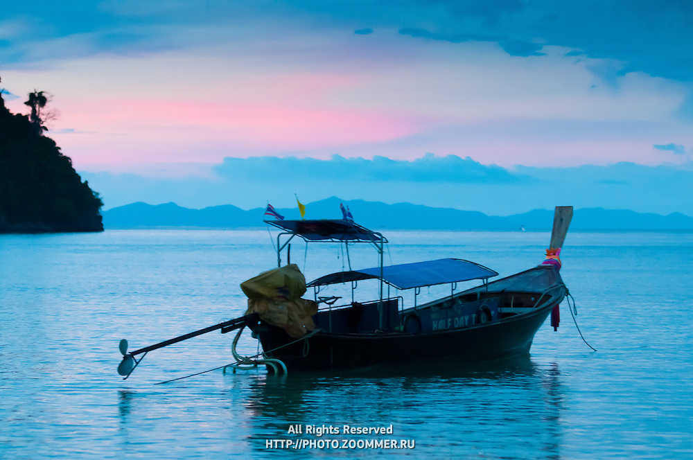 Silhouette of longtail boat on the sunset near Phi-Phi island, Thailand