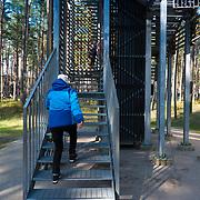 Woman climbing the Dzintari tower in Dzintari park, Jurmala, Latvia