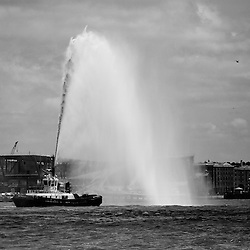 Smit Trafalgar one of the local fire tugs sprays a huge stream of water into the air as part of the Tall Ships Race festivities.