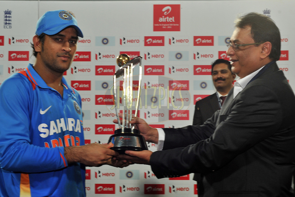 Mahendra Singh Dhoni captain of India  receives the Airtel cup after winning the series 5-0 India won the final and 5th One Day International ( ODI ) match between India and England by 75 runs, held at the Eden Gardens Stadium, Kolkata on the 23rd October 2011..Photo by Pal Pillai/BCCI/SPORTZPICS
