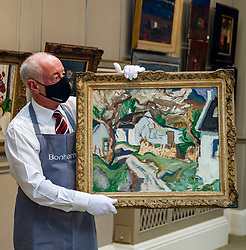 Pictured: Danny Mcilwraith holds onto High Corrie, Arran by John McLauchlan Milne RSA (1816-1957)<br /><br />A fabulous selection of paintings by the world-famous Scottish Colourists – Samuel Peploe, George Leslie Hunter, Francis Cadell and J.D Fergusson – lead the Bonhams Scottish Art sale.<br /><br />They include pictures from a fine private collection of Scottish Art led by Peploe's Still Life with Tureen and Fruit. Painted around 1926, Still Life with Tureen and Fruit shows the influence of the French Post-Impressionist master Paul Cézanne. Peploe's compositions were meticulously planned and executed, creating the dialogue between object and space for which he and his fellow Colourists were renowned  which is estimated at £120,000-180,000.<br /><br />Other Scottish Colourist works on show include:<br />Anemones in a Yellow Vase by George Leslie Hunter (1877-1931). Dating from the mid to late 1920s – a golden period for Hunter still lives – Anemones in a Yellow Vase shows the influence of Matisse on the artist's work. Estimate: £50,000-80,000.<br /><br />Gypsy in a Landscape by Peploe (1871-1935). Originally thought to be a portrait of Margaret, the artist's wife, dressed as a gypsy, the work painted around 1900 is now widely believed to depict one of the Blyth sisters, who were related to the kings of the Gypsies. Estimate: £60,000-80,000.<br /><br />Peonies in a Silver Vase by Peploe. In the 1890s, Peploe studied in Paris, where he was greatly influenced by the work of Edouard Manet, Jean-Baptiste-Camille Corot, Jean-Baptiste-Siméon Chardin and Gustave Courbet. During further training in Holland, he discovered the seventeenth-century Dutch painters, especially Frans Hals. From a distillation of these influences, he developed his own tonal style as seen in this work which he painted around 1897 shortly after he settled back in Edinburgh. Estimate: £60,000-80,000.<br /><br />Paris street scene by John Duncan Fergusson RBA (1874-1961). Between 1907 and 1914 Fergus