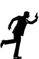 spy criminal policeman detective  man running holding gun full length silhouette in studio isolated white background