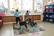 """Nederland, Herpen, 20090128...Kinderopvang 'Op de boerderij' in Herpen...""""OP DE BOERDERIJ"""" kinderopvang..is gevestigd bij een vleesveebedrijf te Herpen...Jongens spelen met autootjes op een spelmat met wegen.....Netherlands, Herpen, 20090128. ..Childcare on the farm in Herpen. ..""""ON THE FARM"""" childcare ..is located at a beef farm in Herpen...Boys playing with cars.    .."""