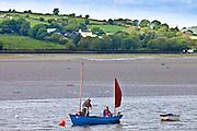 Fishermen on fishing boat in Courtmacsharry Bay, County Cork, Ireland
