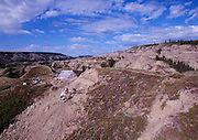 Paleontologist Phil Currie's excavates at Dinosaur Provincial Park, a site previously discovered in the early 1900's by Barnum Brown of the American Museum of Natural History that contained Albertasaurs.