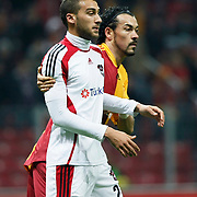 Galatasaray's Servet CETIN (R) and Gaziantepspor; Cenk TOSUN (L) during their Turkey Cup Quarter final matchday 2 Galatasaray between Gasiantepspor at the AliSamiYen Turk Telekom Arena in Istanbul Turkey on Wednesday 02 March 2011. Photo by TURKPIX