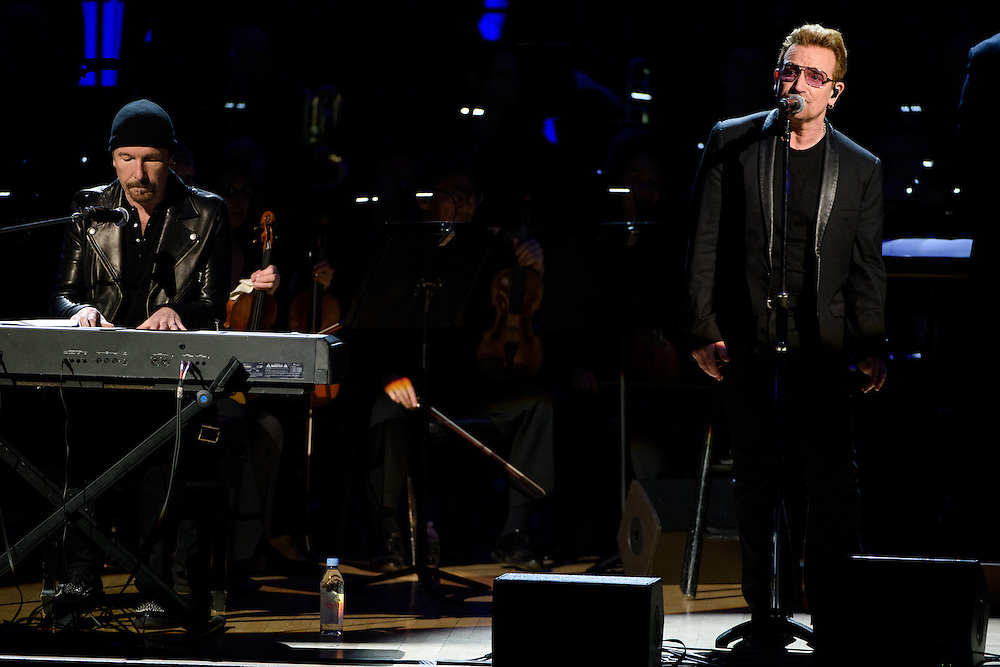 """Photos of Bono and The Edge of U2 performing live for the """"It Always Seems Impossible Until It Is Done"""" World AIDS Day event at Carnegie Hall in New York, NY on December 1, 2015. © Matthew Eisman/ Rolling Stone. All Rights Reserved"""