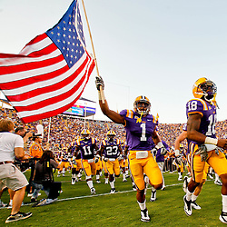 September 10, 2011; Baton Rouge, LA, USA;  LSU Tigers safety Eric Reid (1) runs out with an American flag during introductions prior to kickoff of a game against the Northwestern State Demons at Tiger Stadium.  Mandatory Credit: Derick E. Hingle