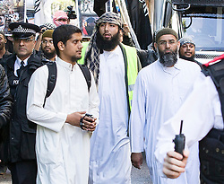© Licensed to London News Pictures . London , UK . Siddhartha Dhar (second L holding a camera) and Anjem Choudary (R) at a Muslims Against Crusades demonstration outside the American Embassy in Grosvenor Square on the tenth anniversary of the 9/11 attacks in London on September 11, 2011. There has been speculation that Siddhartha Dhar is this the new 'Jihadi John', who appeared in a recent ISIS video . Photo credit : Joel Goodman/LNP