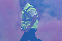 Football - 2018 / 2019 Premier League - West Ham United vs. Tottenham Hotspur<br /> <br /> A steward clears a flare thrown by the West Ham fans at the London Stadium<br /> <br /> COLORSPORT/DANIEL BEARHAM