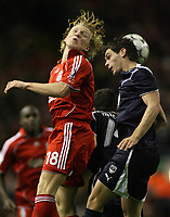 Photo: Paul Thomas.<br /> Liverpool v Bordeaux. UEFA Champions League, Group C. 31/10/2006.<br /> <br /> Dirk Kuyt (L) of Liverpool beats Johan Micoud for the ball.
