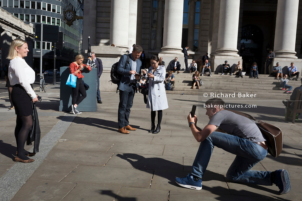 A businesswoman stands for a photo beneath the neo-classical pillars of Royal Exchange in the City of London - the capital's financial centre (aka The Square Mile), on 27th September 2018, in London, England.