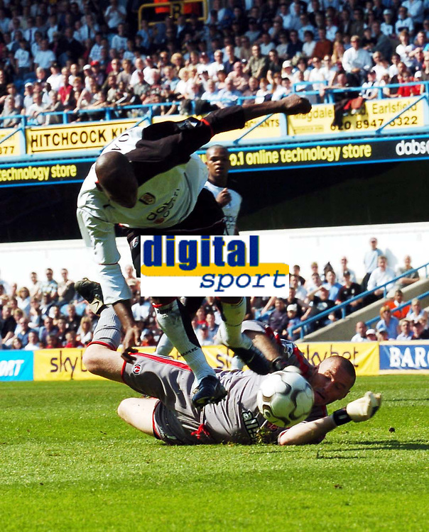 Foto: Digitalsport<br /> NORWAY ONLY<br /> Picture: Henry Browne.<br /> Date: 24/04/2004.<br /> Fulham v Charlton Athletic FA Barclaycard Premiership.<br /> <br /> <br /> Luis Boa Morte is sent flying by Dean Kiely to earn Fulham a penalty.