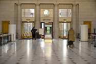Union Station, Washington, DC, USA--March 16, 2019. Two women are in the lobby of Union Station in the District of Columbia. One is headed for the doo