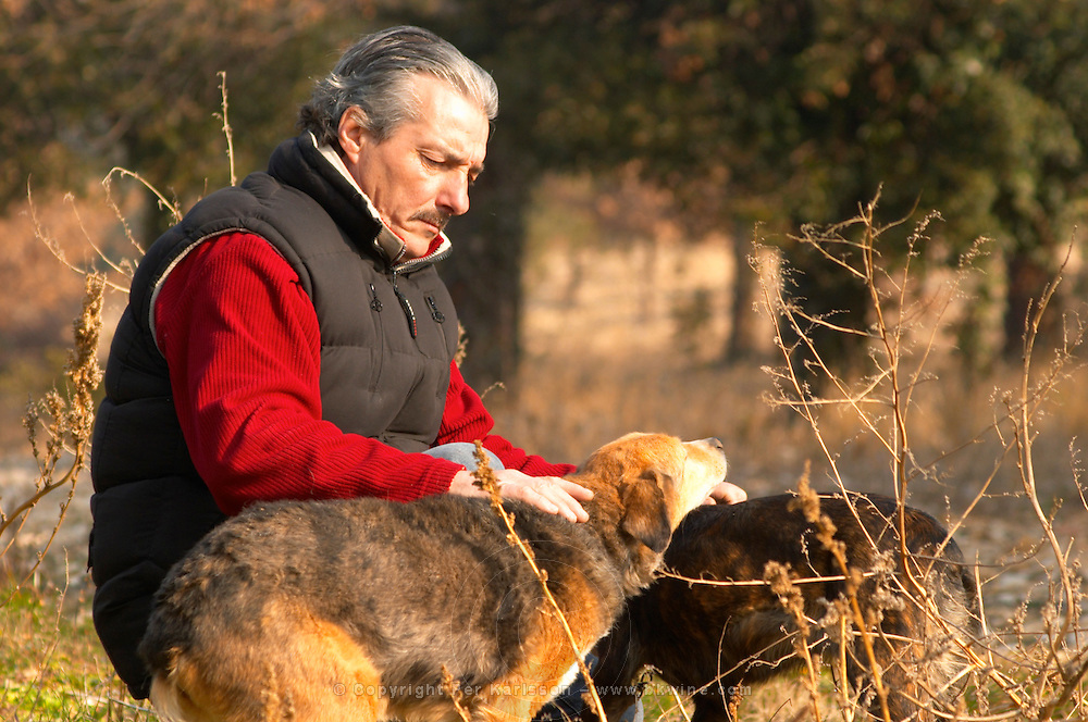 A truffle hunter with two truffle dogs at La Truffe de Ventoux truffle farm, Vaucluse, Rhone, Provence, France