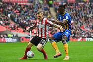 Michael Bostwick of Lincoln City (16) and Omar Beckles of Shrewsbury Town (6) battle for the ball during the EFL Trophy Final match between Lincoln City and Shrewsbury Town at Wembley Stadium, London, England on 8 April 2018. Picture by Stephen Wright.