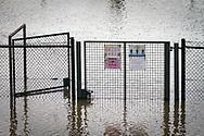 flood of the Rhine on February 5th. 2021, flooded tennis courts in the district Poll, gate, fence, Cologne, Germany.<br /> <br /> Hochwasser des Rhein am 5. Februar 2021, ueberflutete Tennisplaetze am Rheinufer in Poll, Tor, Zaun, Koeln, Deutschland.