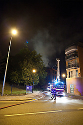 © Licensed to London News Pictures. 10/08/2011. Salford, UK. A fire in a building opposite the Renault Garage on Trinity Way. Scenes of desctruction in Manchester, where people rioted and looted and premesis were set alight. Photo credit : Joel Goodman/LNP
