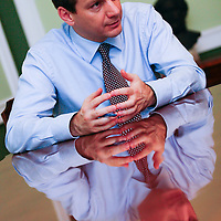 Economy minister Gordon Bajani is reflected on his desk during an interview in his office in the ministry.