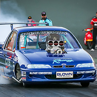 Ian Foster driving his Holden Commodore Ute Supercharged Outlaw at the Perth Motorplex's Top Fuel Challenge in November 2005