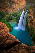 Havasu Falls in its namesake canyon, near Havasupai village. Havasu Canyon is a side canyon to the Grand canyon, and is populated by the Supai tribe.
