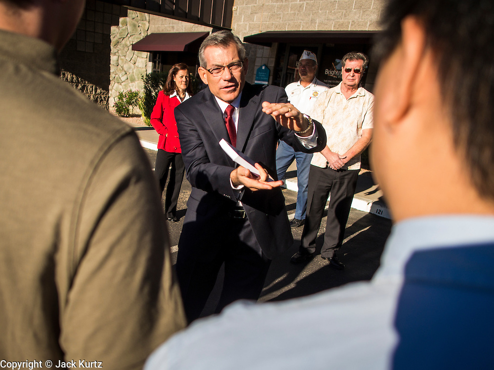 09 NOVEMBER 2013 - PHOENIX, AZ: US Representative DAVID SCHWEIKERT (R-AZ), center, talks to constituents in front of his district office in Scottsdale. Congressman Schweikert represents Arizona's 6th Congressional District. Most of the district is in Scottsdale, a wealthy suburb of Phoenix and one of the wealthiest cities in the United States. Schweikert is a staunch conservative and popular with the Tea Party. He supported the government shutdown in October.    PHOTO BY JACK KURTZ