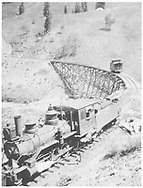 """RGS 2-8-0 #6 at south end of Upper Gallagher trestle with short caboose stranded on the trestle """"after losing coupling.""""<br /> RGS  Gallagher, CO  Taken by Virden, Walter - 1906<br /> In book """"Southern, The: A Narrow Gauge Odyssey"""" page 150<br /> See RD155-079 for original and RD155-080 for identical photo."""