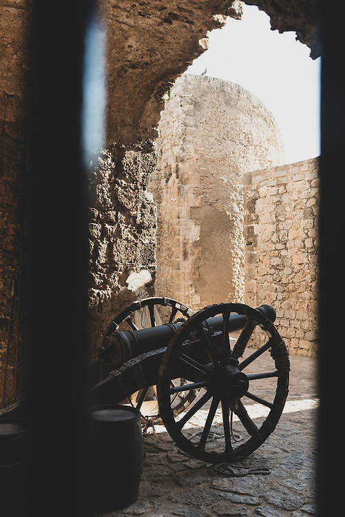 Ibiza town, Spain - August 1, 2018: An old cannon on display inside  Ibiza's citadel walls.