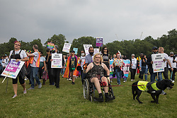 London, UK. 24th July, 2021. Thousands of LGBTI+ protesters arrive in Hyde Park for a Queer Picnic following the first-ever Reclaim Pride march. Reclaim Pride replaced the traditional Pride in London march, which many feel has become too commercial and strayed from its roots in protest, and was billed as a People's Pride march for LGBTI+ liberation.