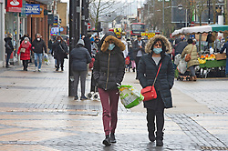 © Licensed to London News Pictures 15/02/2021.        Bexleyheath, UK. Shoppers at the Broadway in Bexleyheath, South East London today during a third national coronavirus lockdown. Non-essential shops could open in weeks if the Covid-19 infection rate keeps dropping. Photo credit:Grant Falvey/LNP