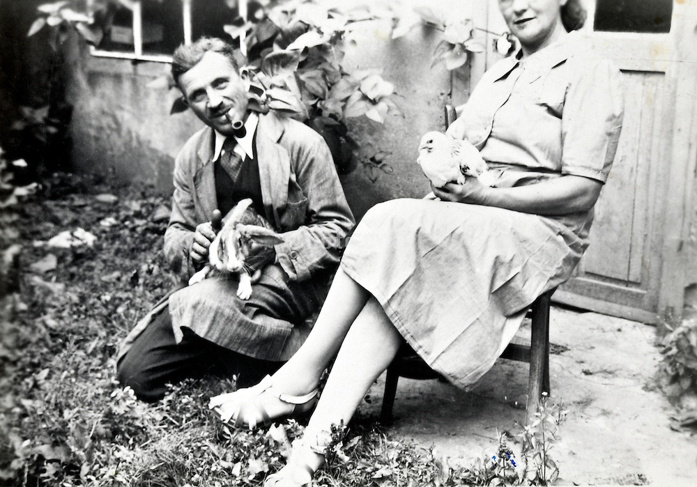 adults posing in the backyard France 1950s