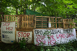 Banners draped around the perimeter of Stop HS2's Wendover Active Resistance Camp are pictured on 16th June 2021 in Wendover, United Kingdom. Large areas of land around Wendover in the Chilterns AONB have already been cleared of trees and vegetation for the HS2 rail infrastructure project in spite of concerted opposition from local residents and environmental activists.