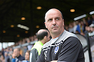 Paul Cook, the Portsmouth manager looks on from the touchline before k/o. Skybet football league two match, Cambridge Utd v Portsmouth at the Abbey Stadium  in Cambridge on Saturday 10th October 2015.<br /> pic by John Patrick Fletcher, Andrew Orchard sports photography.