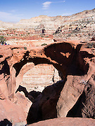 Specatators watch a climber. Scene from Cassidy Arch, Capitol Reef National Park, Utah.