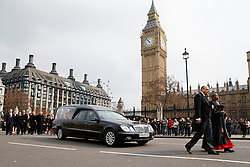 © licensed to London News Pictures. London, UK 27/03/2014.The coffin of Tony Benn leaving Houses of Parliament ahead of his funeral at Margaret's Church, Westminster, London. Former cabinet minister and veteran left-wing campaigner Tony Benn died at home on March 14th following a long term illness. Photo credit: Tolga Akmen/LNP