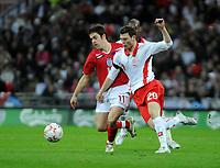 Photo: Tony Oudot/Richard Lane Photography. <br /> England v Switzerland. International Friendly. 06/02/2008. <br /> Joe Cole of England beats Stephan Lichtsteiner of Switzerland to the ball