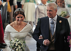 Princess Eugenie walks down the aisle with her father, the Duke of York, for her wedding to Jack Brooksbank at St George's Chapel in Windsor Castle.