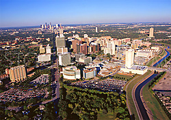 Aerial view of the Texas Medical Center and Houston, Texas skyline featuring Braes Bayou.