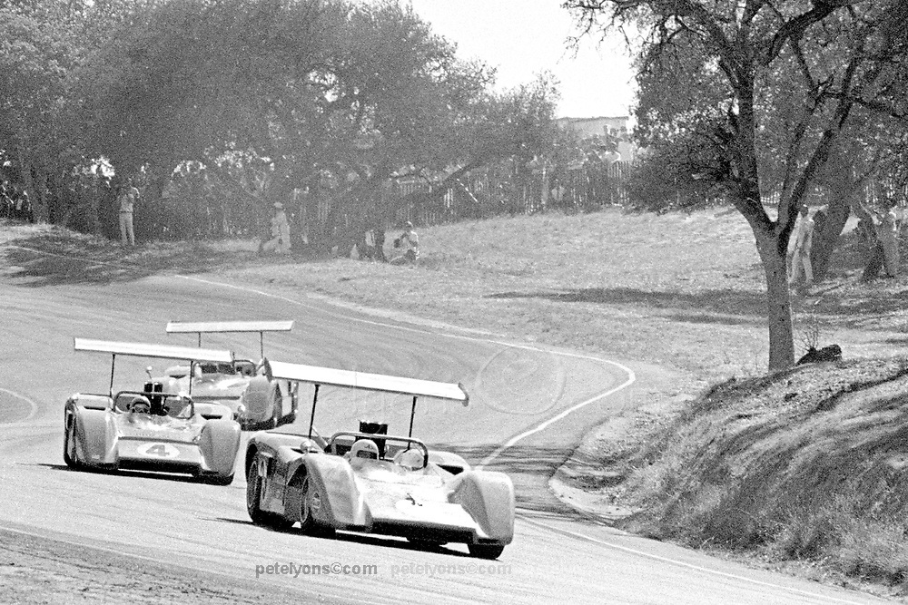 Trio of McLaren M8Bs plunging down from the Corkscrew corner during the 1969 Laguna Seca Can-Am. In front here, about to be lapped, is the day's guest driver, former McLaren team member Chris Amon. In number 4 is race winner and 1969 Can-Am series champion Bruce McLaren, with regular team mate Denny Hulme just behind. The McLaren M8B was by far the dominant car of that year's Can-Am, winning all 11 of the races. PHOTO BY Pete Lyons 1969 / www.petelyons.com
