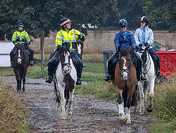 Licensed to London News Pictures. 14/09/2021. London, UK. Horse riders brave the rain this morning on Wimbledon Common south-west London as weather forecasters issue yellow weather warnings for heavy rain and thunderstorms for London and the South East today with the potential of flooding to homes and businesses and disruption to travel networks. However, sunny warm weather is expected from tomorrow with highs of 24c. Photo credit: Alex Lentati/LNP