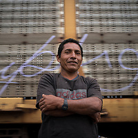 Benjamin is from La Libertad, El Salvador. He has worked in many jobs, all of them with low pay. His last job was looking after swimming pools and he carries documents to prove it, for potential customers. Here he is waiting to board the train known as La Bestia in Apizaco, Mexico, on his way to the US. Including elderly and young children, there are 14 people in his family, he hopes to provide for them better than he can do in El Salvador. He's never missed a day of work.