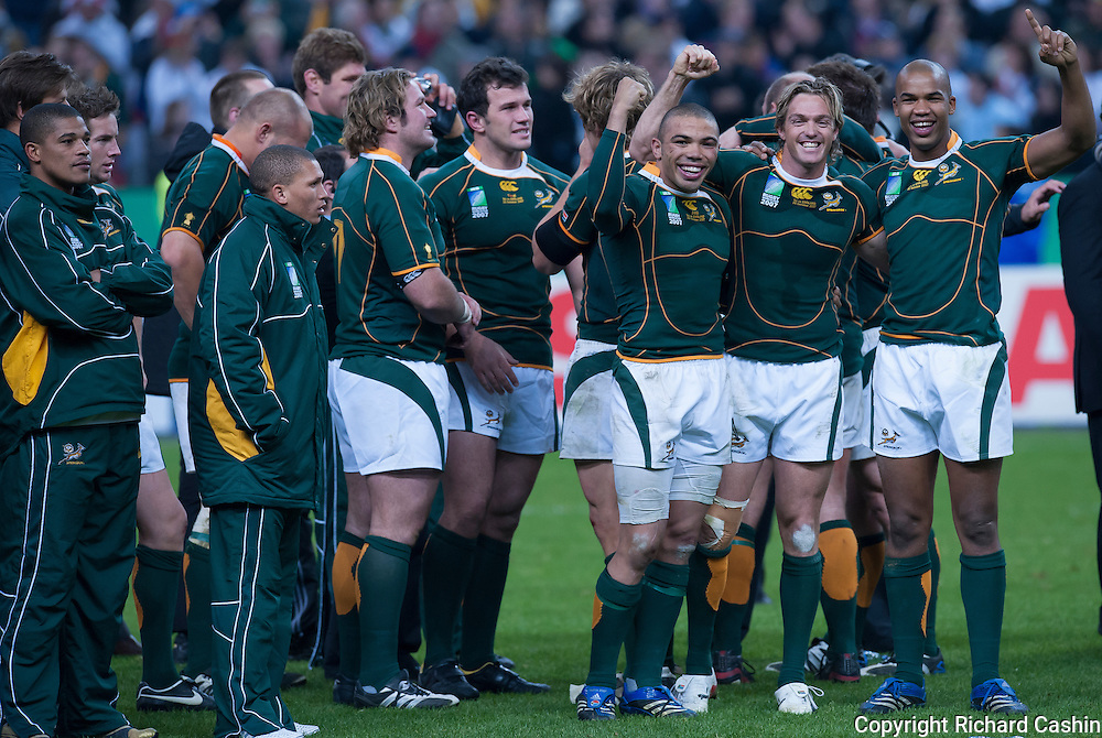 Bryan Habana, Percy Montgomery, JP Pietersen celebrate after the 2007 Rugby World Cup Final at Stade de France in Paris, France