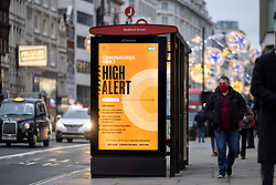 © Licensed to London News Pictures. 10/12/2020. London, UK. Pedestrians walk past a public health advert about the risk of Coronavirus in central London. Photo credit: Rob Pinney/LNP
