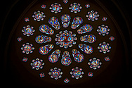 Medieval western rose  window of the Gothic Cathedral of Chartres, France. A UNESCO World Heritage Site. The western rose, made c.1215 and 12m in diameter shows the Last Judgement - a traditional theme for west façades. A central oculus showing Christ as the Judge is surrounded by an inner ring of 12 paired roundels containing angels and the Elders of the Apocalypse and an outer ring of 12 roundels showing the dead emerging from their tombs and the angels blowing trumpets to summon them to judgement. .<br /> <br /> Visit our MEDIEVAL ART PHOTO COLLECTIONS for more   photos  to download or buy as prints https://funkystock.photoshelter.com/gallery-collection/Medieval-Middle-Ages-Art-Artefacts-Antiquities-Pictures-Images-of/C0000YpKXiAHnG2k