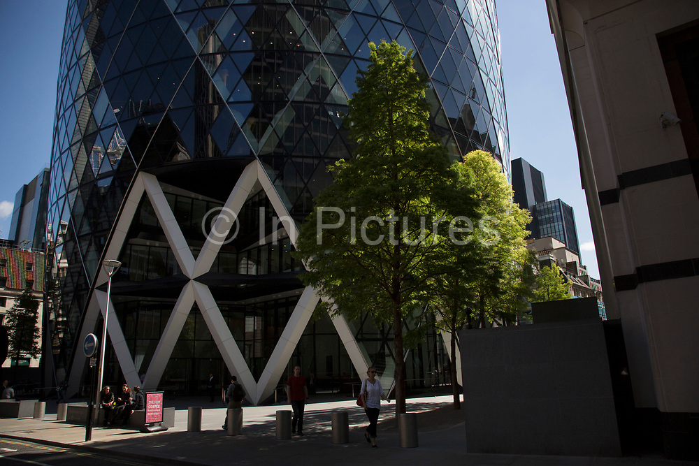 Exterior of the Gherkin at 1 St Mary Axe in the City of London, United Kingdom. This iconic building is one of the best loved buildings in London with its distinctive bullet like shape and twisted glass structure.