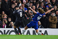 Football - 2018 / 2019 Emirates FA Cup - Fourth Round: Chelsea vs. Sheffield Wednesday<br /> <br /> Chelsea's Ethan Ampadu gets to the ball before Sheffield Wednesday's Joey Pelupessy - Referee Andre Marriner gave a penalty that was later overturned by VAR, at Stamford Bridge.<br /> <br /> COLORSPORT/ASHLEY WESTERN