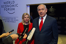 HANDOUT - Benjamin Netanyahu, Prime Minister of Israel, Office of the Prime Minister of Israel, Israel and his wife at the Annual Meeting 2018 of the World Economic Forum in Davos, January 25, 2018. Photo by Greg Beadle/World Economic Forum via ABACAPRESS.COM